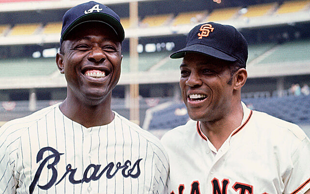 CINCINNATI, OH - JULY 1970:  Hank Aaron #44 of the Atlanta Braves poses with Willie Mays #24 of the San Francisco Giants before the 1970 All-Star Game on July 14, 1970 at Riverfront Stadium in Cincinnati, Ohio. (Photo by Herb Scharfman/Sports Imagery/Getty Images) *** Local Caption ***  Hank Aaron; Willie Mays