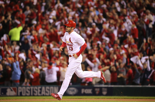 Matt Carpenter rounds the bases after hitting a solo home run in the third inning during Game 2 of the National League Championship Series between the St. Louis Cardinals and the San Francisco Giants on Sunday, Oct. 12, 2014, at Busch Stadium in St. Louis. (J. B. Forbes/St. Louis Post-Dispatch/MCT)