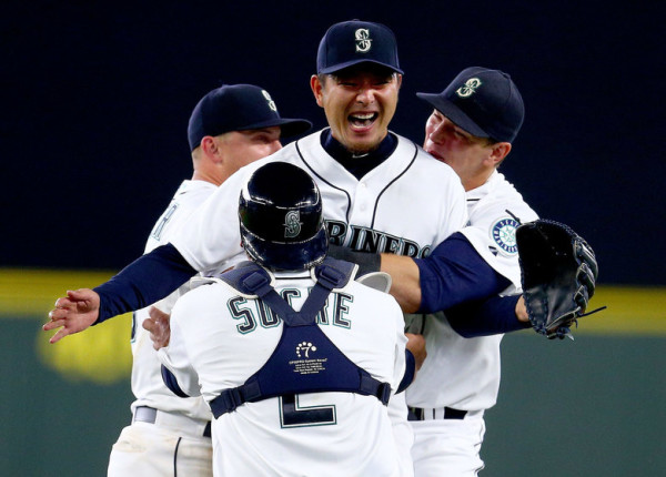 Seattle Mariners pitcher Hisashi Iwakuma is mobbed by teammates after throwing a no-hitter to defeat the Baltimore Orioles 3-0 on Wednesday, August 12, 2015, at Safeco Field in Seattle, Wash. MAJOR LEAGUE BASEBALL - MARINERS VS. ORIOLES - NO HITTER - HISASHI IWAKUMA - 149384 - 081215 (John Lok / The Seattle Times)
