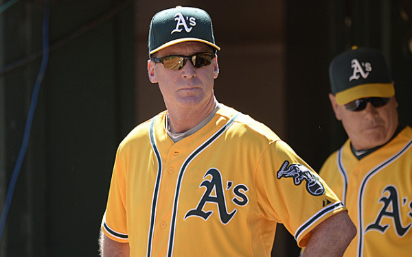 Sep 22, 2013; Oakland, CA, USA; Oakland Athletics manager Bob Melvin (6) watches the game from the dugout during the first inning against the Minnesota Twins at O.co Coliseum. Mandatory Credit: Bob Stanton-USA TODAY Sports
