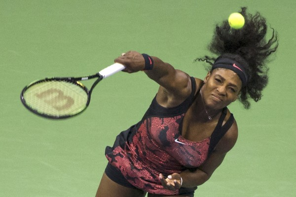 Serena Williams of the U.S. serves to compatriot Bethanie Mattek-Sands during their third round match at the U.S. Open Championships tennis tournament in New York, September 4, 2015. REUTERS/Adrees Latif