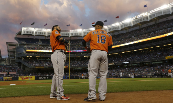 Houston Astros Marwin Gonzalez, left, talks to Astros first baseman Luis Valbuena (18) before the start of the Astros baseball game against the New York Yankees at Yankee Stadium in New York, Tuesday, Aug. 25, 2015. (AP Photo/Kathy Willens) ORG XMIT: OTKKW109