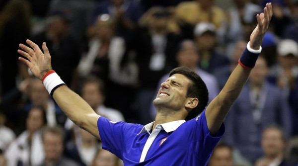 Novak Djokovic, of Serbia, reacts after defeating Roger Federer, of Switzerland, in the men's championship match of the U.S. Open tennis tournament, Sunday, Sept. 13, 2015, in New York. (AP Photo/David Goldman)
