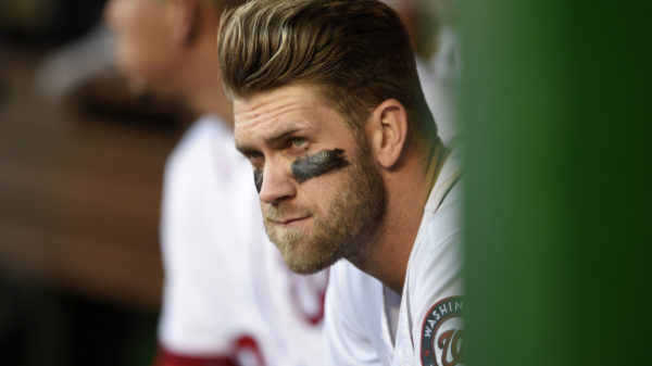 Washington Nationals' Bryce Harper watches from the dugout during the team's baseball game against the Atlanta Braves, Thursday, April 14, 2016, in Washington. The Nationals won 6-2. (AP Photo/Nick Wass)