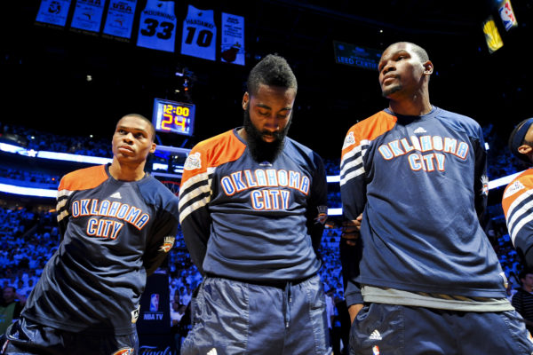 MIAMI, FL - JUNE 17: Oklahoma City Thunder players, from left, Russell Westbrook #0, James Harden #13 and Kevin Durant #35 listen during the National Anthem before facing the Miami Heat in Game Three of the 2012 NBA Finals at American Airlines Arena on June 17, 2012 in Miami, Florida.