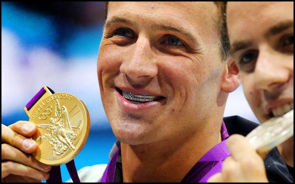 """)LONDON OLYMPICS--SWIMMING- Ryan Lochte smiles with """"grills"""" in after winning the gold medal in the Men's 400m IM race at the Olympics in London, England, .Saturday, July 30, 2012. (Photo by Doug Mills/ The New York Times)"""