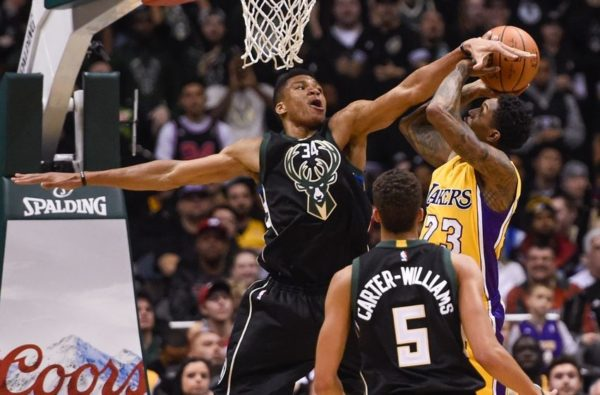Feb 22, 2016; Milwaukee, WI, USA; Milwaukee Bucks forward Giannis Antetokounmpo (34) tries to block a shot by Los Angeles Lakers guard Louis Williams (23) in the second quarter at BMO Harris Bradley Center. Mandatory Credit: Benny Sieu-USA TODAY Sports
