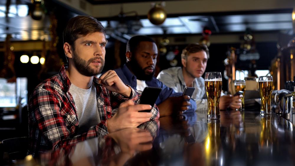 men using bookie apps